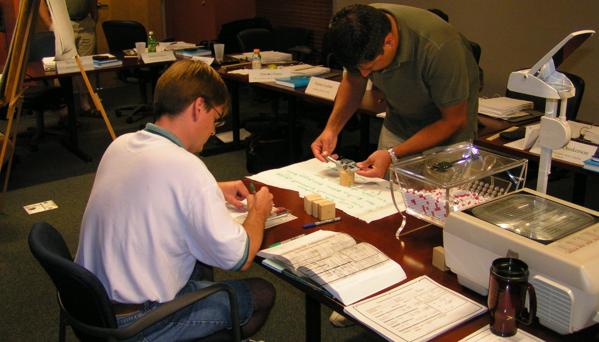 Students processing composite wood samples in the lab